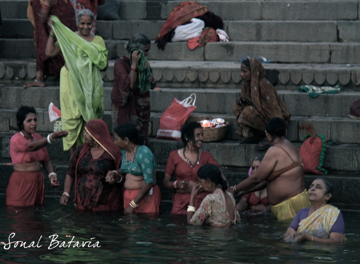 Bathing, praying and chatting in the all mighty Ganga....