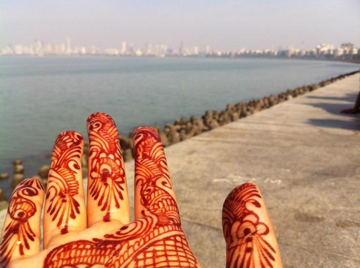 Walking along the sea front on Marine Drive in Mumbai