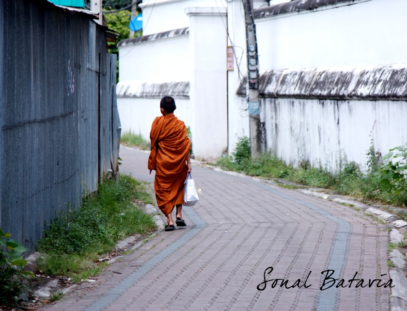 Little monk in training strolling an alley in Chiang Mai.