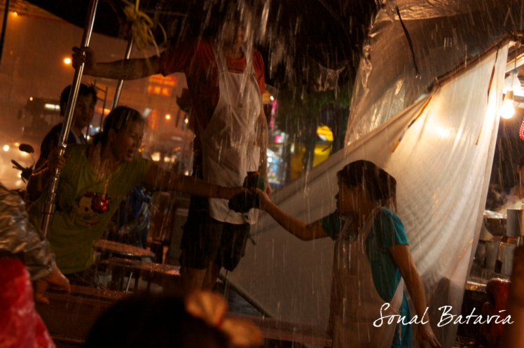 Eve downpour in Bangkok's China town.