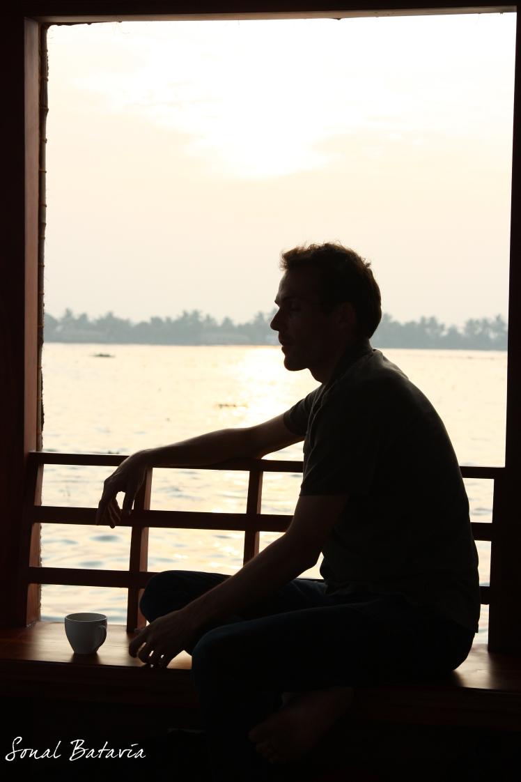Enjoying a cup of South Indian Tea while sailing through Kerala.